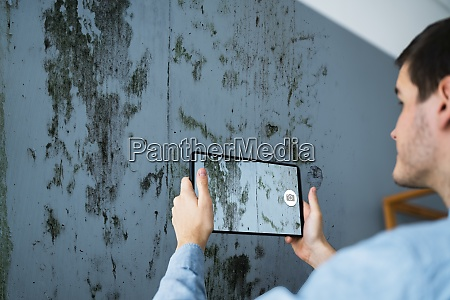 taking photo of home wall mold