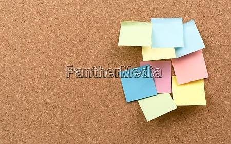 multicolored square sticks are glued to