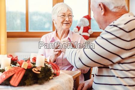 seniors in nursing home exchanging presents