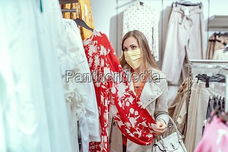 woman shopping in fashion store wearing
