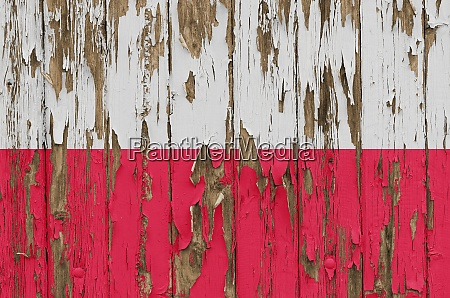 flag of poland on a weathered
