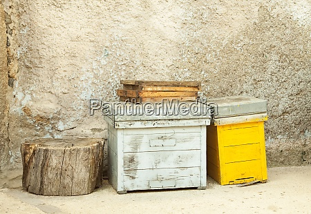 hives and combs waiting to be