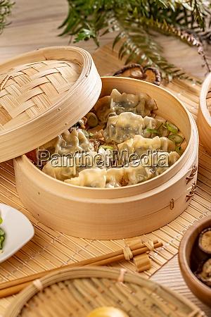bamboo steamer with tasty dumplings