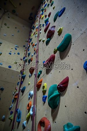 climbing wall with different colored handles