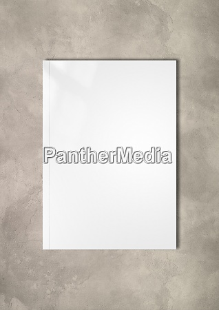 white booklet cover template on concrete