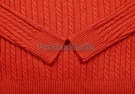 background texture of red knitted wool
