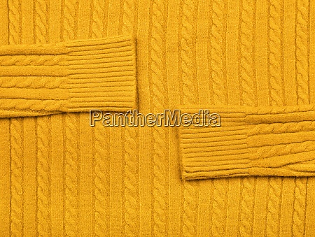 background texture of yellow knitted wool