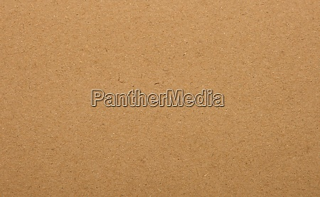 brown paper parchment background with fibers