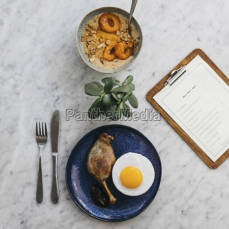apricot porridge and confit duck leg