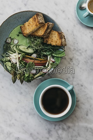 green vegetables and toast with coffee