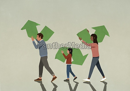 family carrying pieces of green recycling