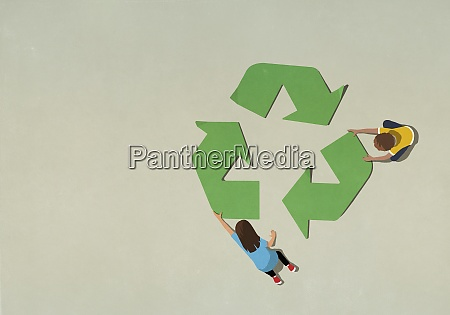 boy and girl assembling green recycling