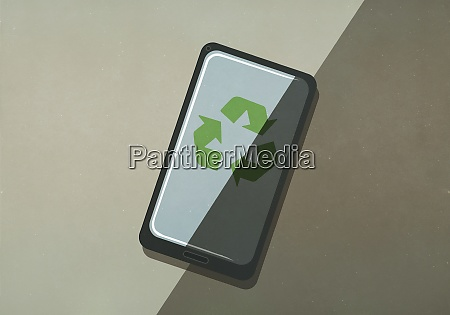 green recycling symbol on smart phone