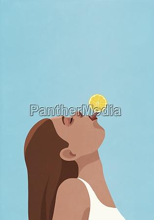 playful young woman balancing lemon on