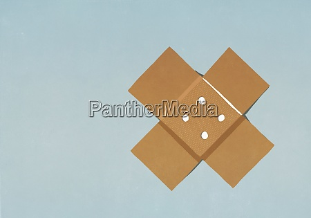 adhesive bandage on blue background