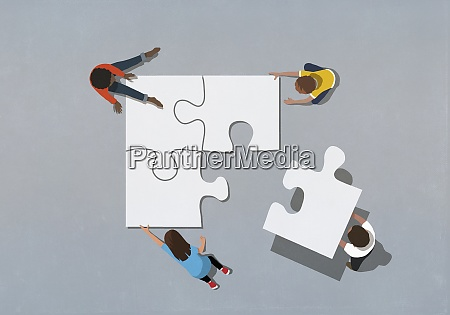 kids finishing puzzle with missing piece
