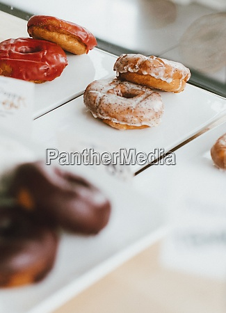 close up donuts on display in
