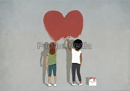 multiethnic girls painting red heart on