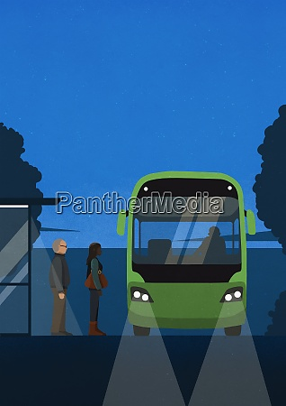 commuters boarding public bus at night