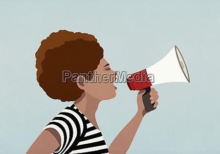 black woman using megaphone at black