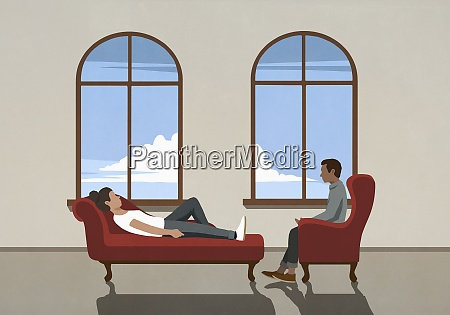 therapist talking to patient on chaise