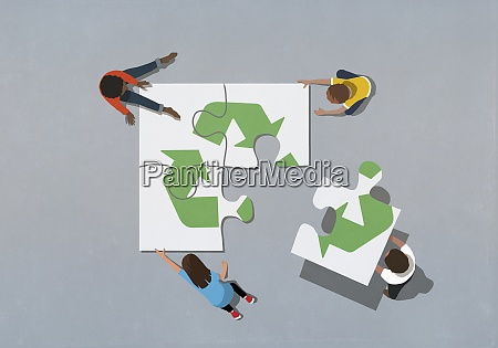 team finishing recycling symbol jigsaw puzzle