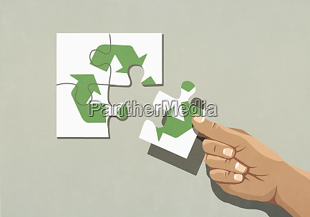 hand finishing recycling symbol jigsaw puzzle