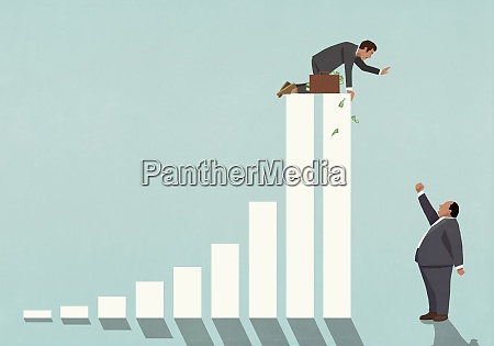 businessman on top of bar graph
