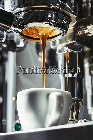 espresso dripping from stainless steel portafilter