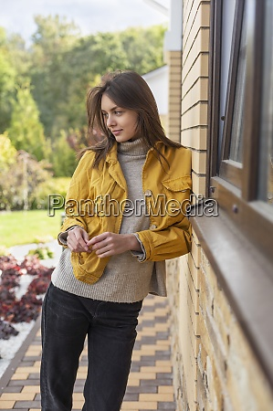beautiful young woman in yellow jacket