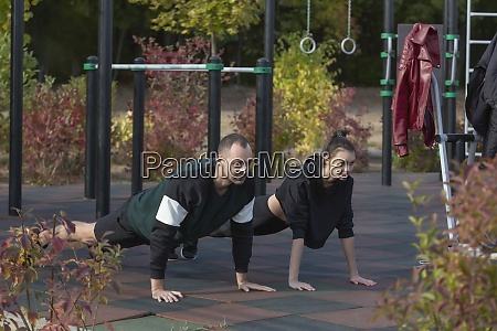 athletic young couple doing plank exercises