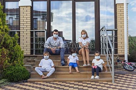 portrait family in face masks on