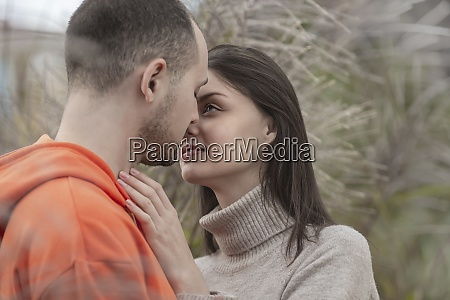 sensual affectionate young couple kissing