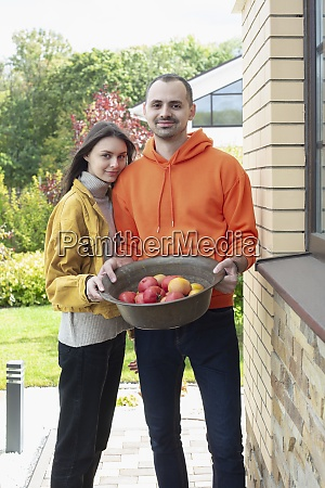 portrait happy young couple with bowl