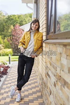 portrait happy young woman in yellow