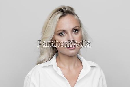 portrait confident serious blonde woman