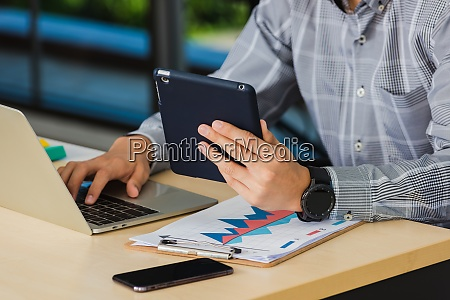handsome man using touchpad checking his