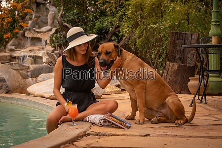 brunette in hat with dog by