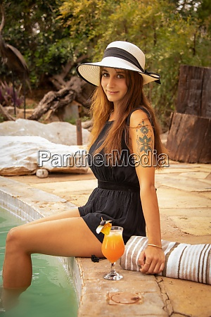 brunette with tattoo with hat by
