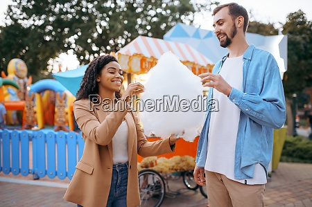 love couple eating cotton candy in