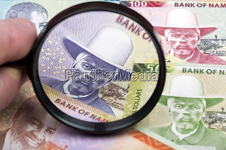 namibian money in a magnifying