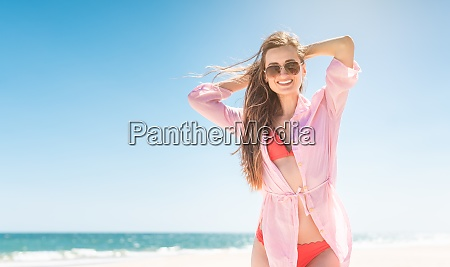 carefree woman on the beach