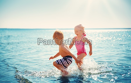 boy and girl playing on the