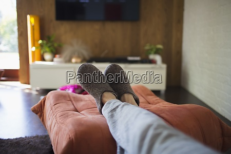 pov woman in slippers relaxing with