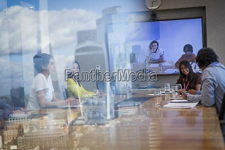 business people video conferencing in urban