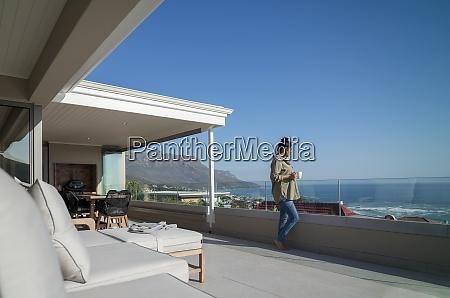 woman enjoying coffee on sunny luxury