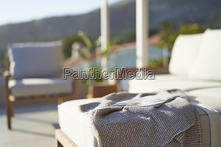 blanket and magazine on sunny patio