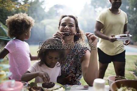 mother and daughter enjoying barbecue lunch