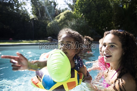 mother and daughter on inflatable raft