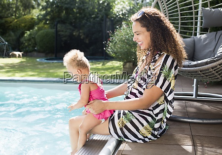 happy mother and toddler daughter at